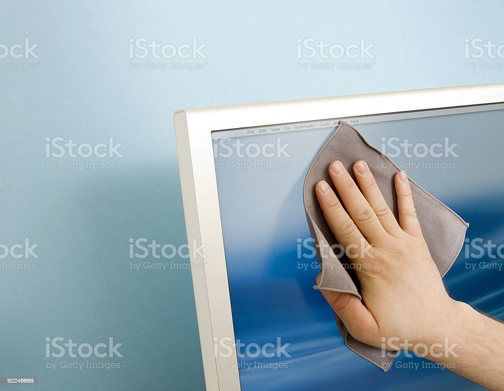 Cleaning a TFT screen royalty-free stock photo