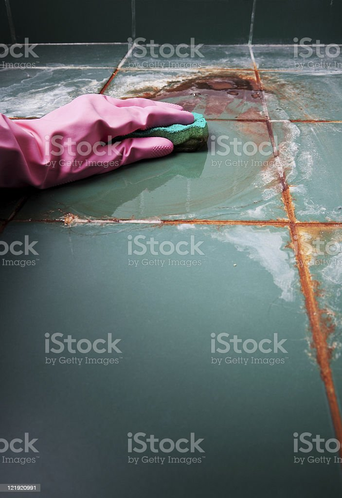 Cleaning a very dirty floor stock photo