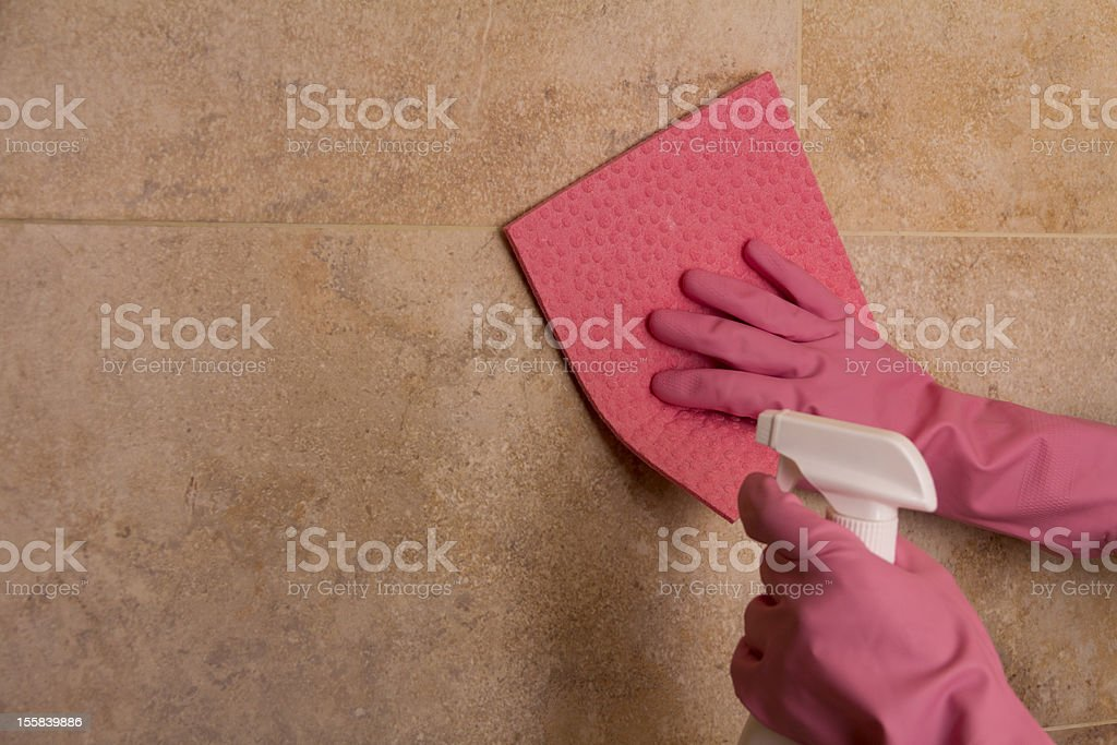 Cleaning a Wall stock photo