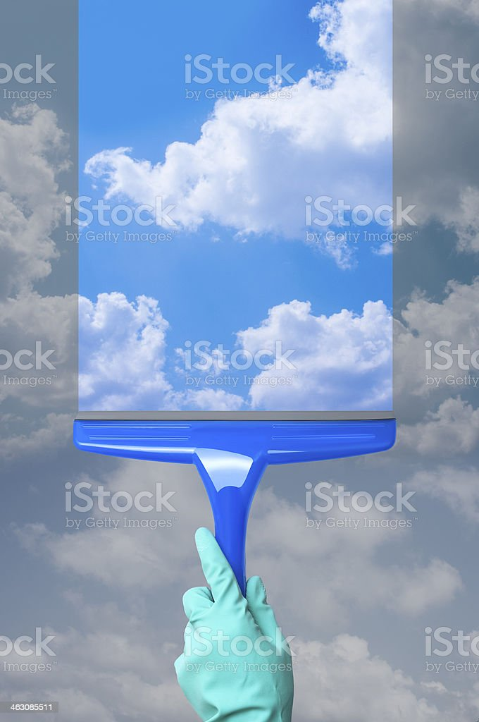 Cleaning a window and seeing a cloudy blue sky stock photo