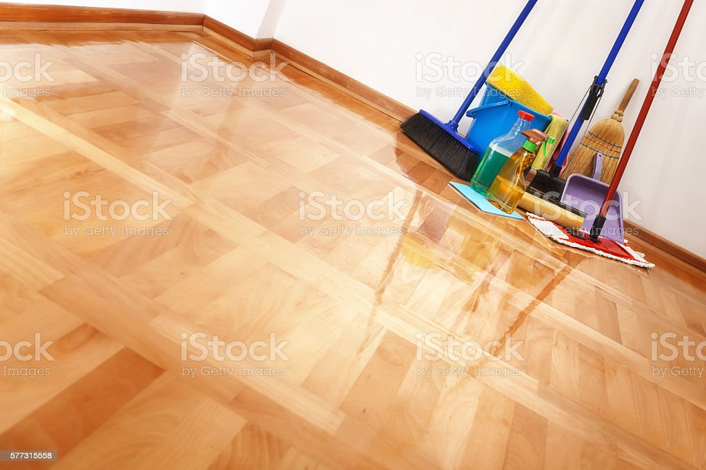 Cleaning accessories on floor room stock photo