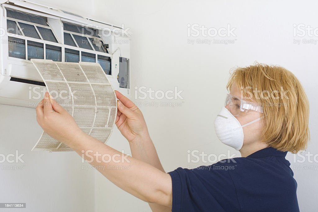 Cleaning air conditioner stock photo
