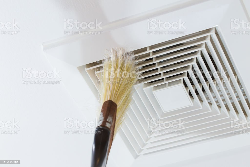 Cleaning Air Duct with Brush, cause of pneumonia in office. stock photo