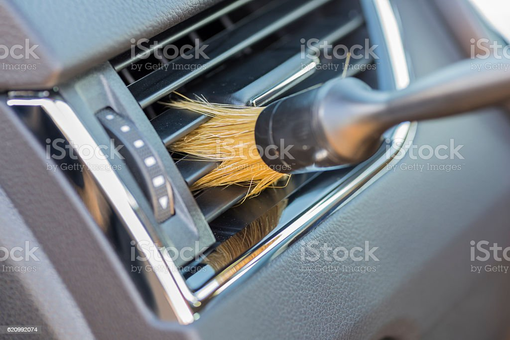 Cleaning air grille. stock photo