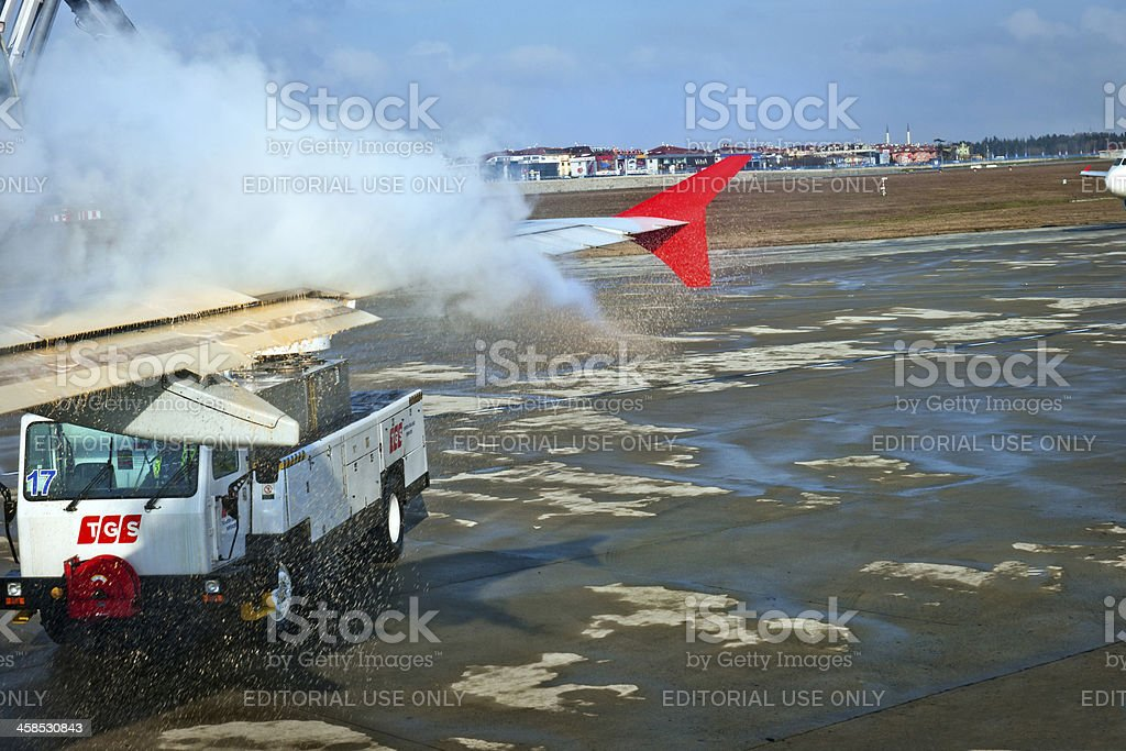 Cleaning Airplane of Snow at Ataturk Airport Turkey stock photo