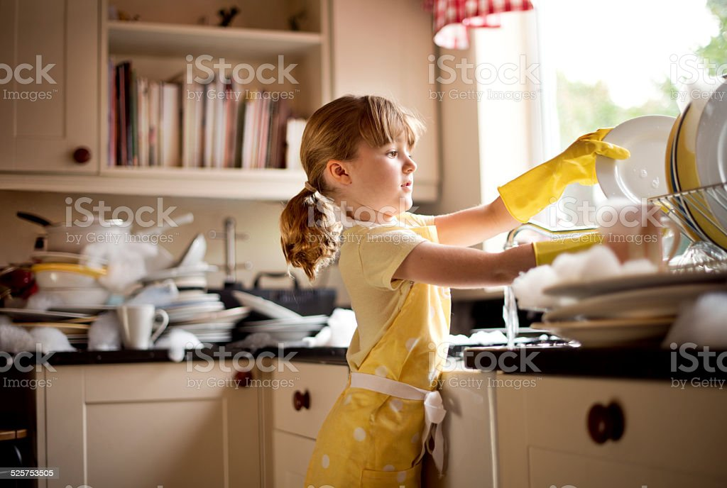 cleaning all the clean dishes again stock photo