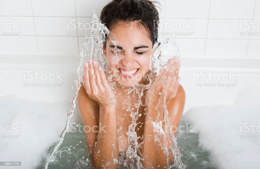 Cleaning and Splashing on Face stock photo