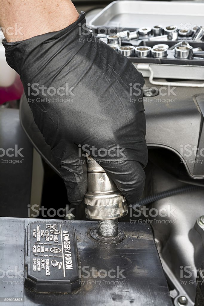 Cleaning battery terminal stock photo