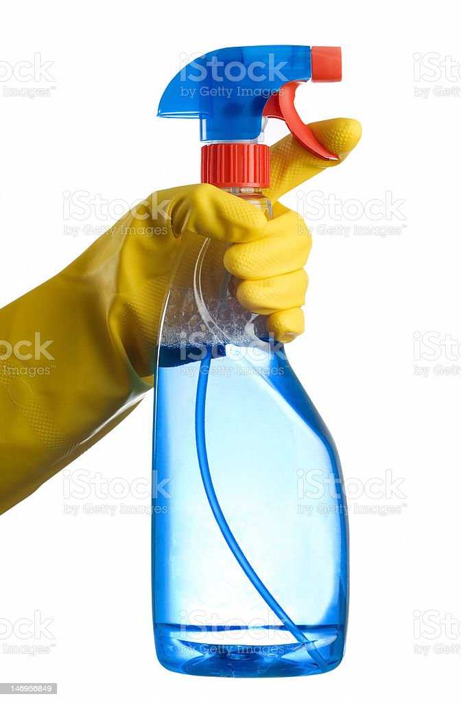 Cleaning bottle and hand royalty-free stock photo