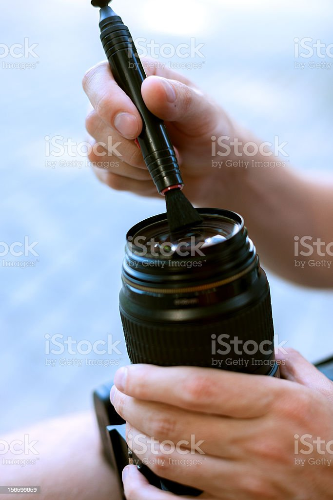 cleaning camera lens stock photo