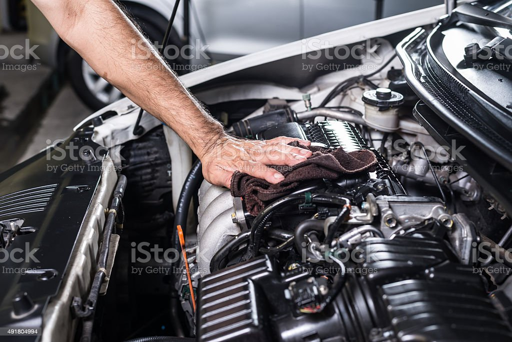 Cleaning car engine stock photo