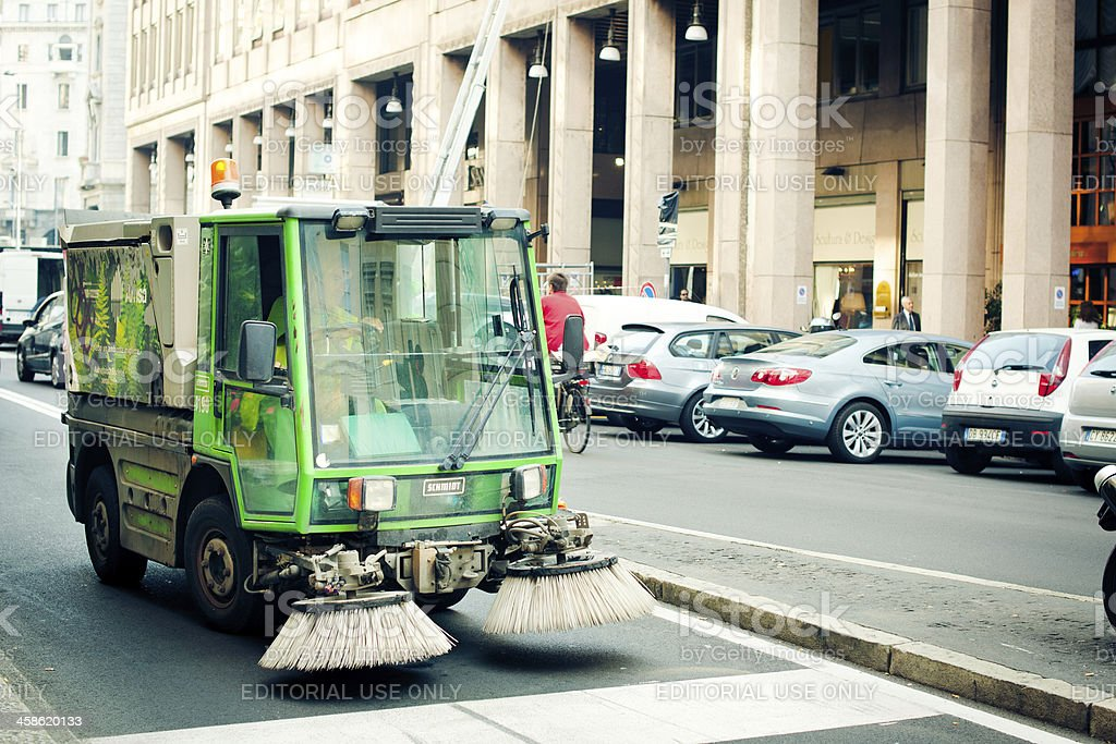 Cleaning car on a Milan street stock photo