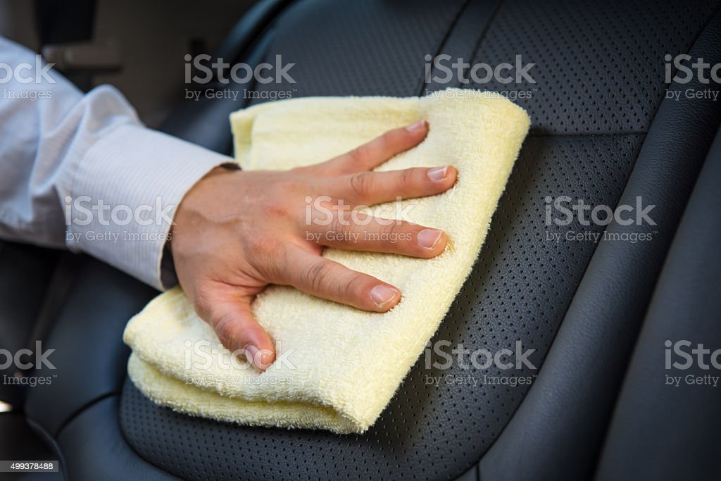 Cleaning car seat stock photo