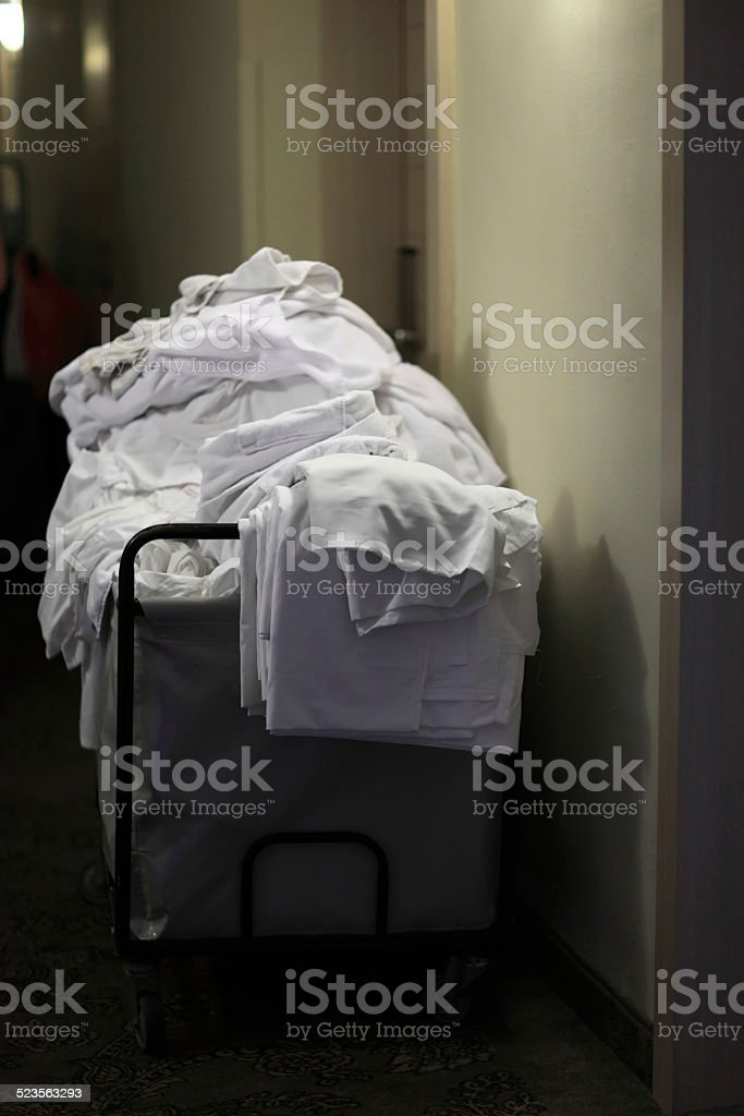 Cleaning cart with bedclothes stock photo