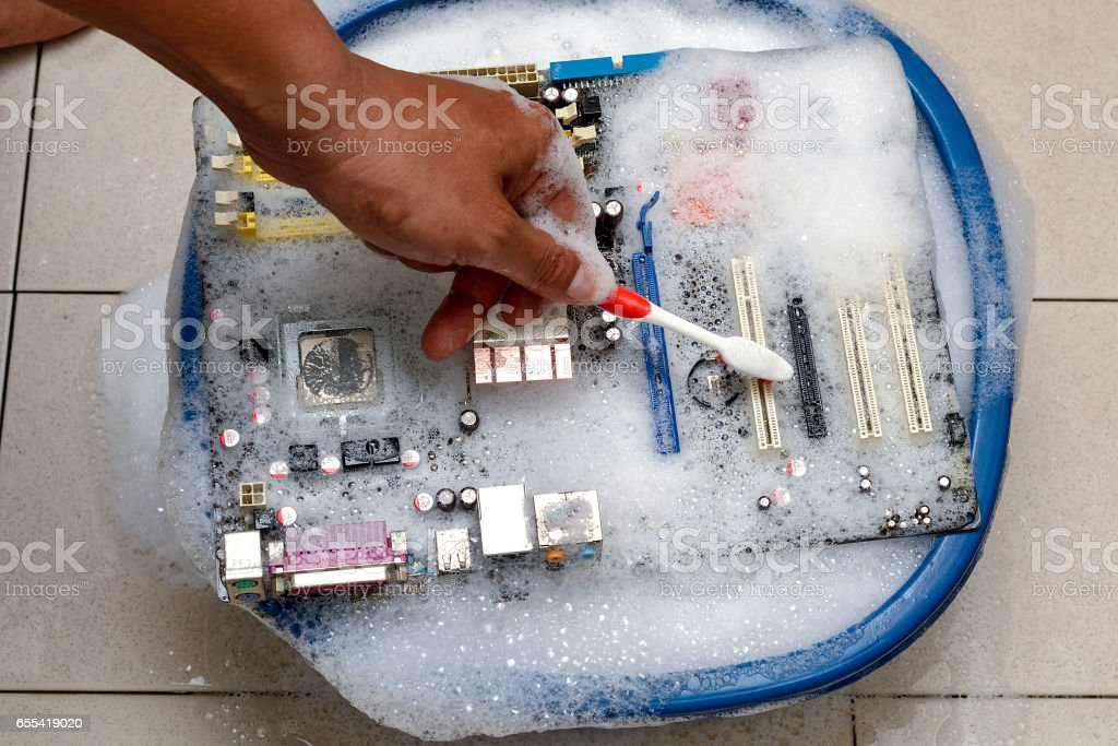 cleaning computer mainboard stock photo
