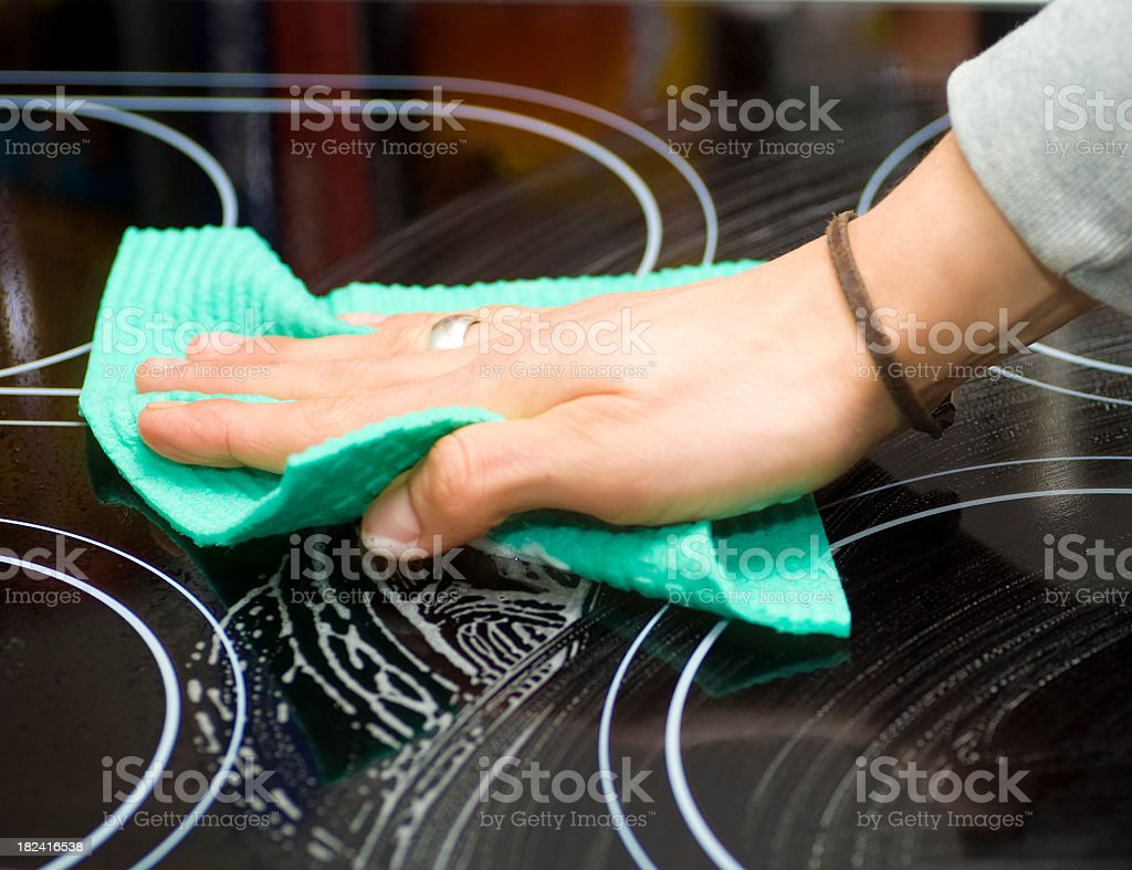 cleaning cookingfield - Cerankochfeld putzen royalty-free stock photo
