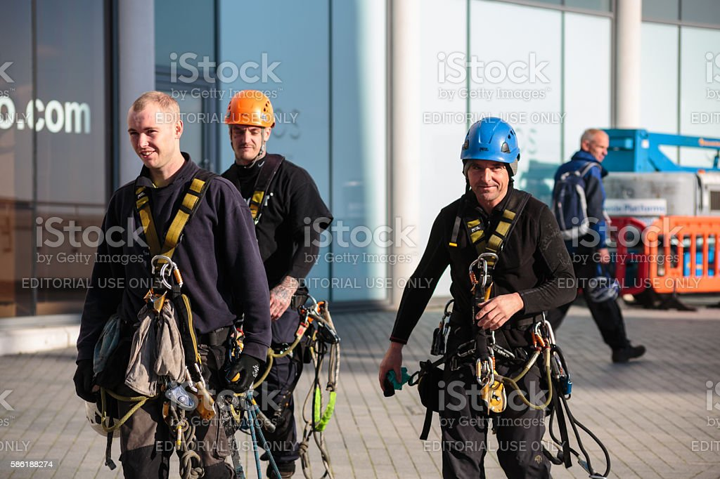 Cleaning crew coming off the Sainsbury's building stock photo
