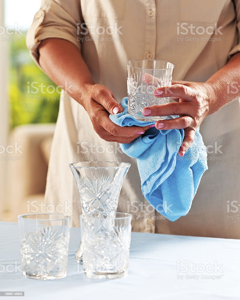 Cleaning crystal glasses royalty-free stock photo
