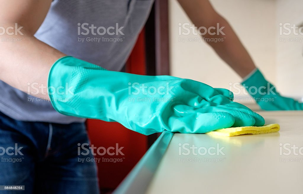 Cleaning desk in the kitchen stock photo