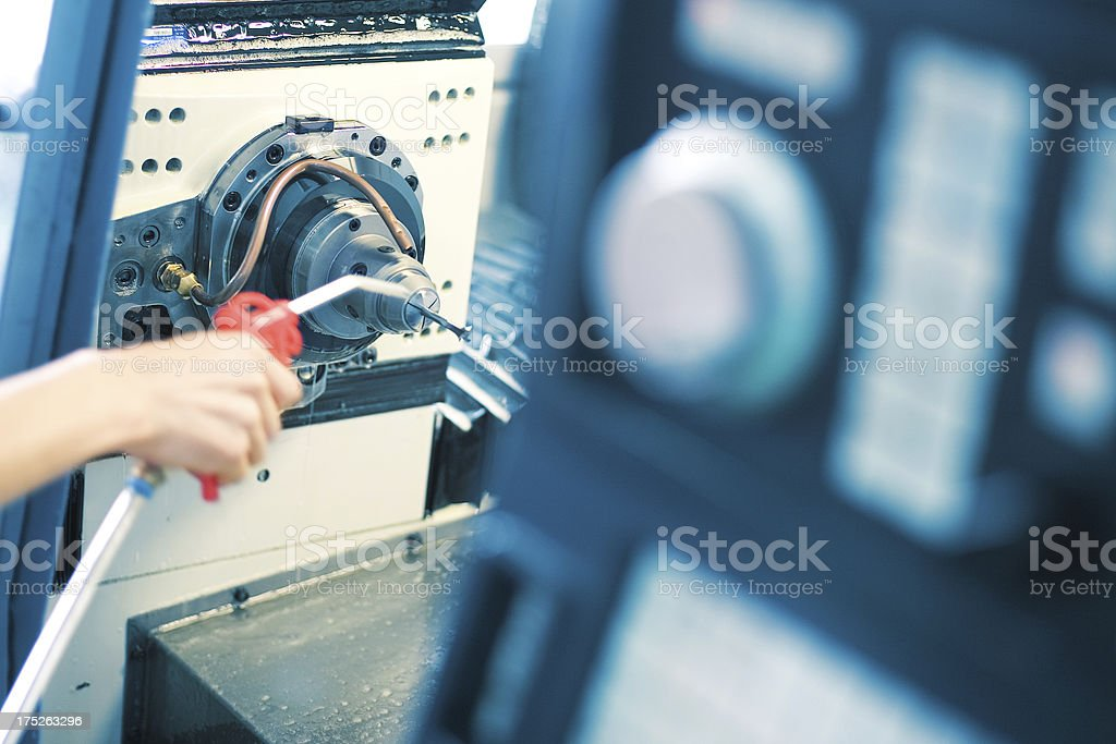 cleaning drilling bit for machining royalty-free stock photo