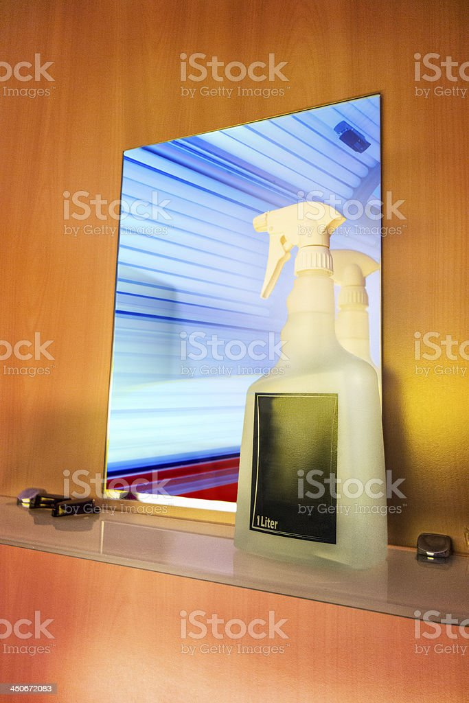 Cleaning equipment for tanning beds in cabin stock photo
