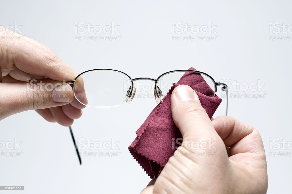 Cleaning Eyeglasses royalty-free stock photo