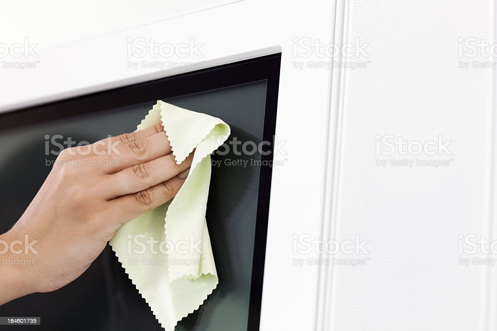 Cleaning Flat-Screen TV royalty-free stock photo