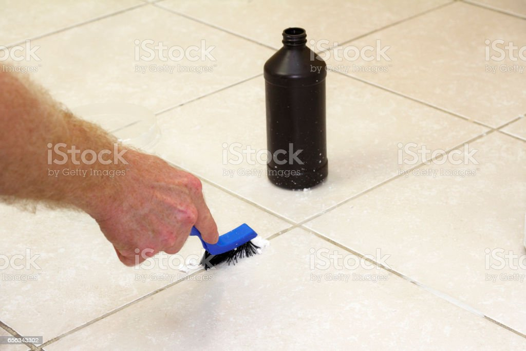 Cleaning Floor Grout with Baking Soda stock photo