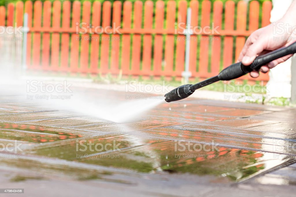 Cleaning floor with high pressure cleaner stock photo