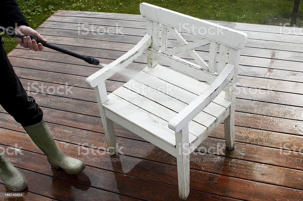 Cleaning Garden Furniture With A Pressure Washer royalty-free stock photo