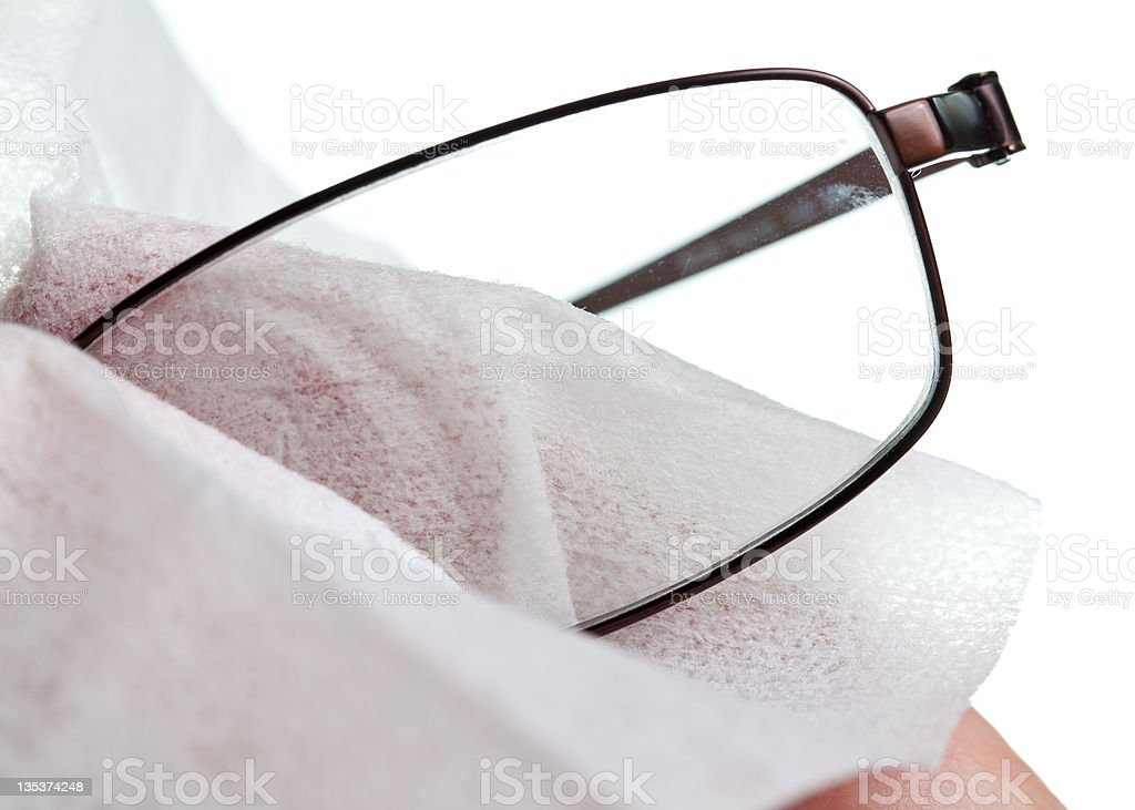 Cleaning glasses with cloth stock photo