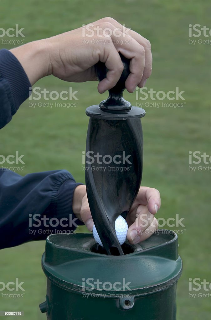 Cleaning golf ball. stock photo