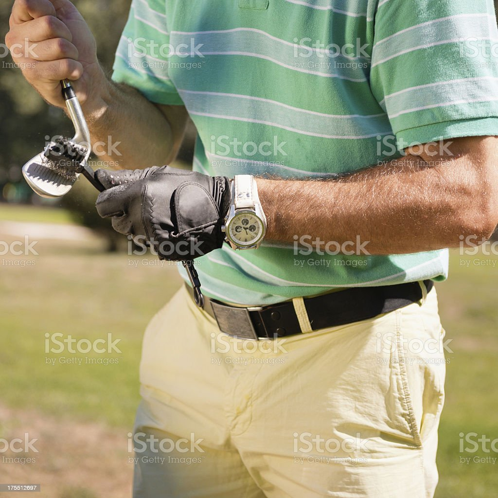 Cleaning golf club royalty-free stock photo
