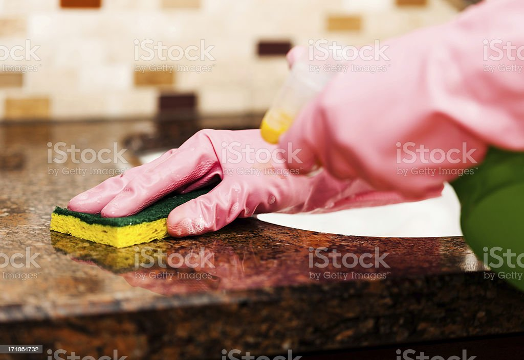 Cleaning granite counter top royalty-free stock photo