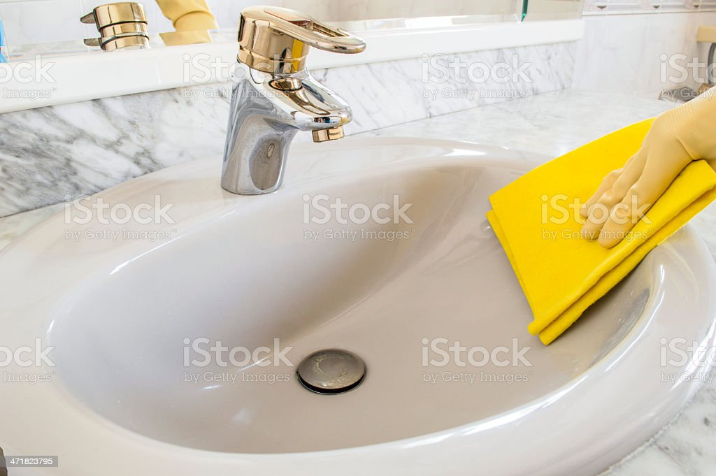 cleaning gray sink with cloth royalty-free stock photo