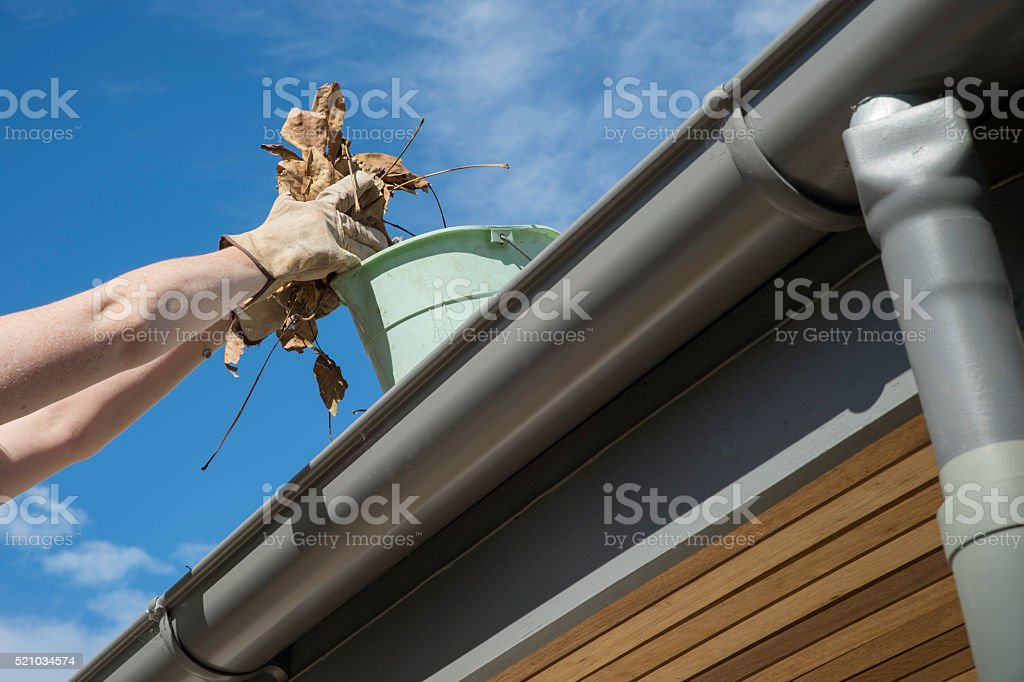 Cleaning gutters stock photo
