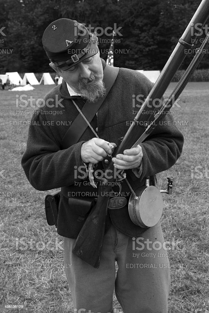 cleaning his rifle royalty-free stock photo