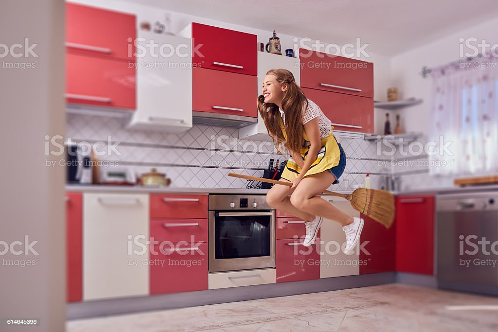 cleaning home and having fun stock photo