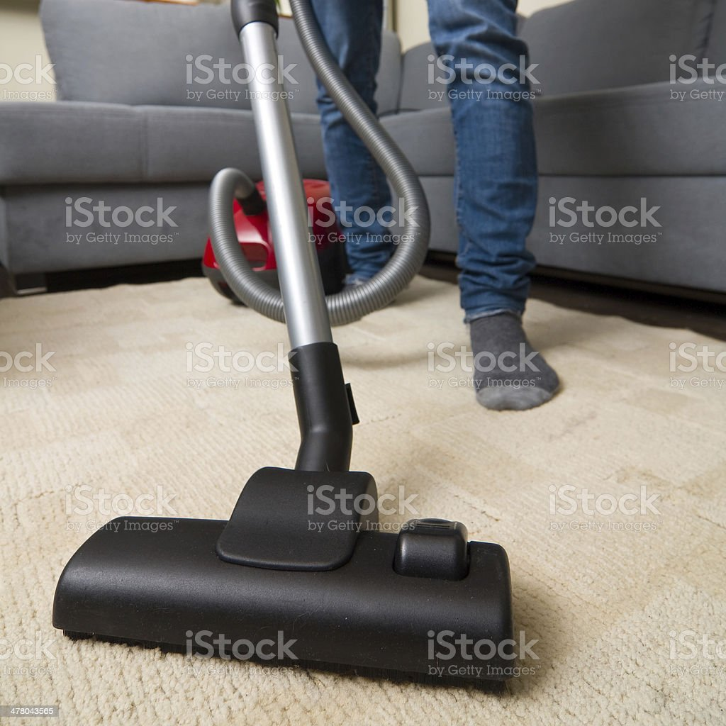 cleaning home with vacuum cleaner stock photo