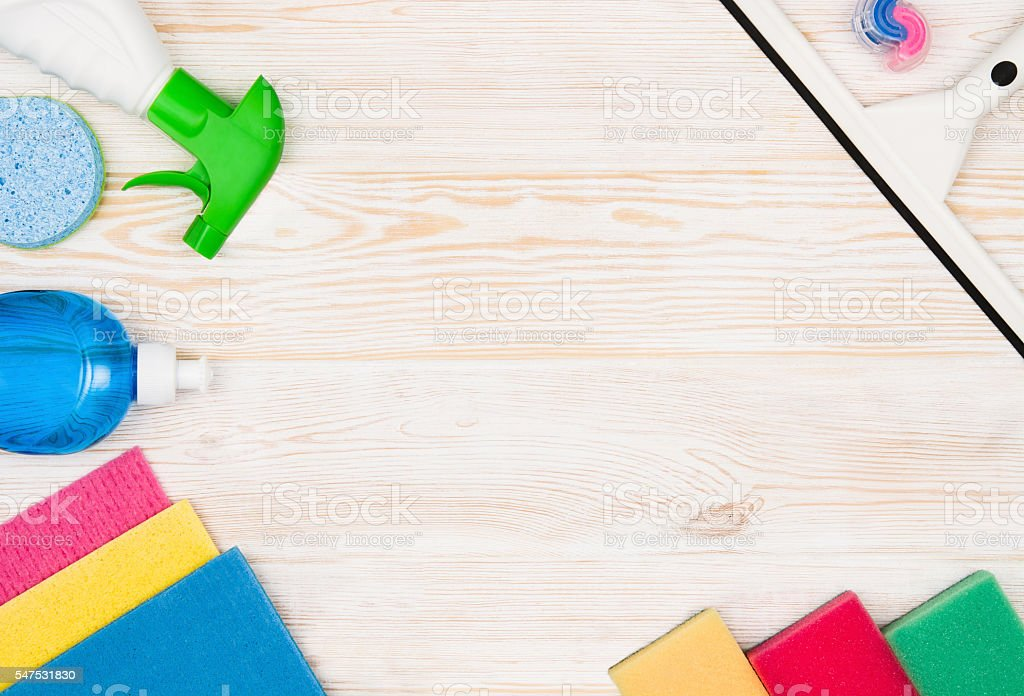 Cleaning items and tools lying on textured white floor background stock photo