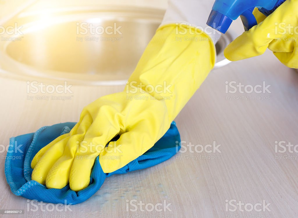 Cleaning kitchen countertop stock photo