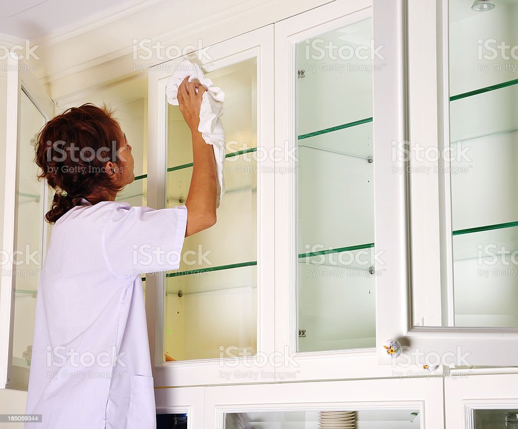 Cleaning kitchen cupboards royalty-free stock photo