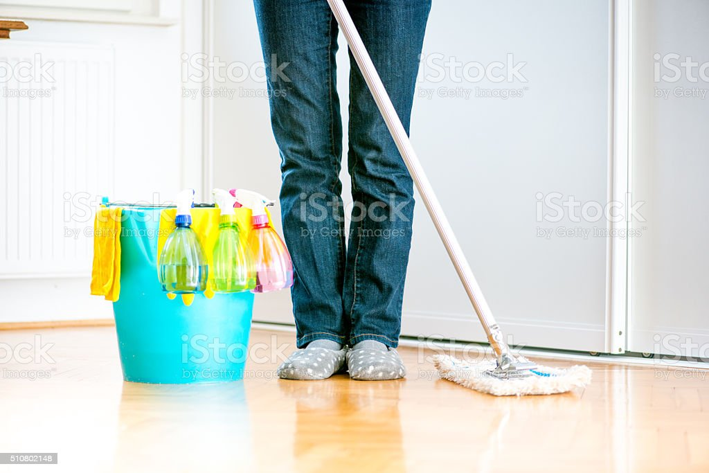 Cleaning Kitchen Floor with Mop stock photo