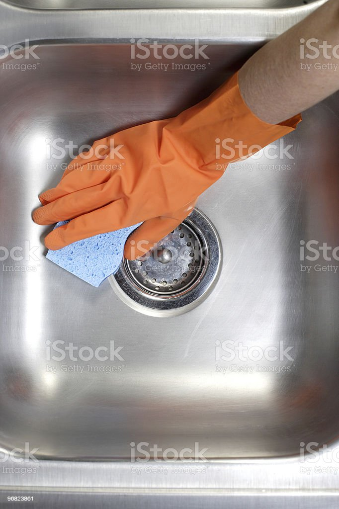 Cleaning Kitchen Sink royalty-free stock photo