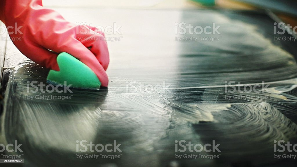 Cleaning kitchen stove. stock photo