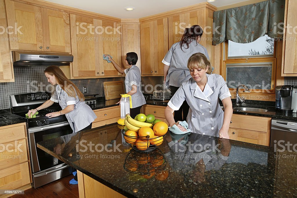 Cleaning Kitchen. Teamwork stock photo