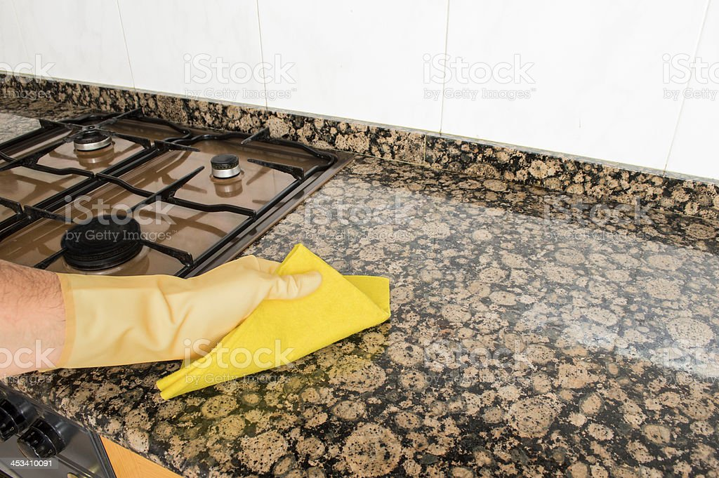 cleaning kitchen with cloth royalty-free stock photo