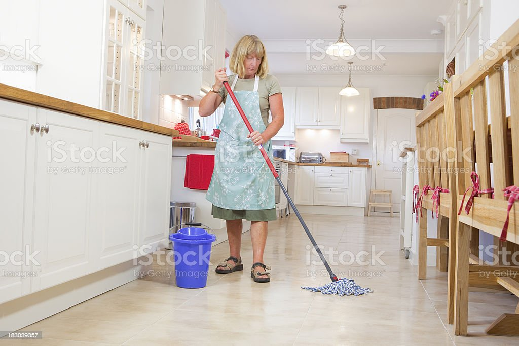 Cleaning Lady Mopping The Kitchen Floor stock photo