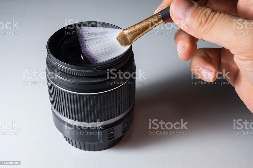 Cleaning lens by brush. stock photo