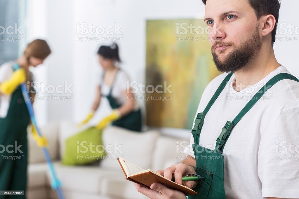 Cleaning man planning new work stock photo